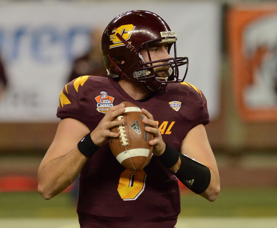 . DETROIT, MI - DECEMBER 26:  Ryan Radcliff #8 of the Central Michigan University Chippewas looks to throw a pass in the first quarter of the Little Caesars Pizza Bowl against the Western Kentucky University Hilltoppers at Ford Field on December 26, 2012 in Detroit, Michigan.  (Photo by Mark A. Cunningham/Getty Images)
