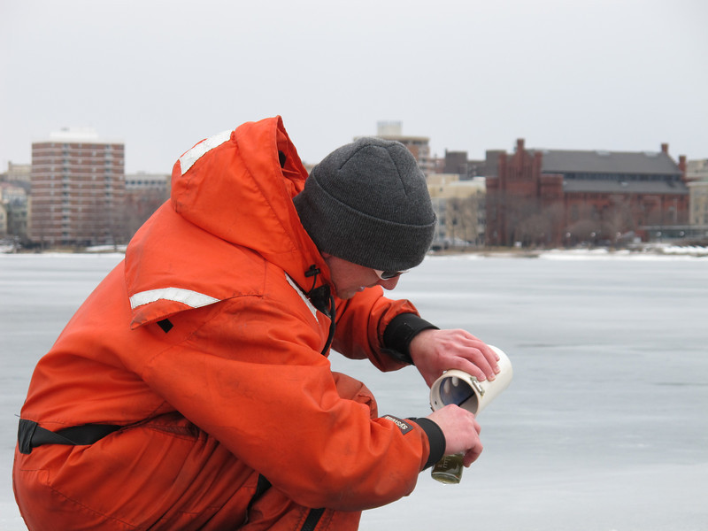 Bier pours his plankton sample into a vial. The sample, he says, more closely resembles what he collects in late Spring plankton tows. Winter samples usually contain far less zooplankton and phytoplankton.