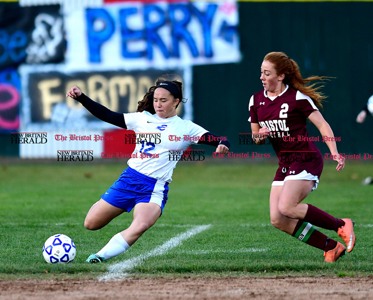 11/1/2016 Mike Orazzi | Staff Bristol Eastern's Leah Policarpio (12) and Bristol Central's Brianna Hamel (2) at Muzzy Field Tuesday evening.