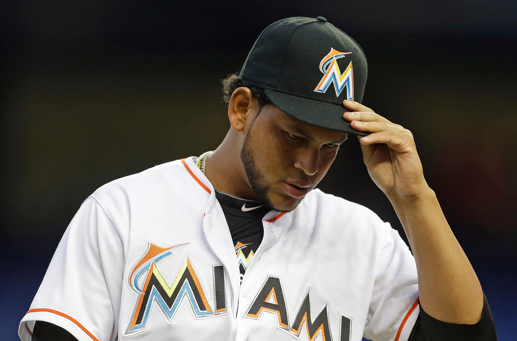 . Miami Marlins starter Henderson Alvarez walks to the dugout after pitching in the first inning of a baseball game against the Colorado Rockies, Wednesday, April 2, 2014, in Miami. (AP Photo/Lynne Sladky)