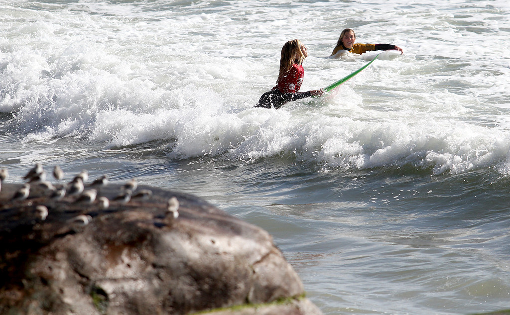 . Competitors make their way into the lineup Sunday, Feb. 24, 2013.morning during the Santa Cruz Scholastic Surf League contest at Pleasure Point in Capitola, Calif. (Jon Weiand/Santa Cruz Sentinel Sentinel)