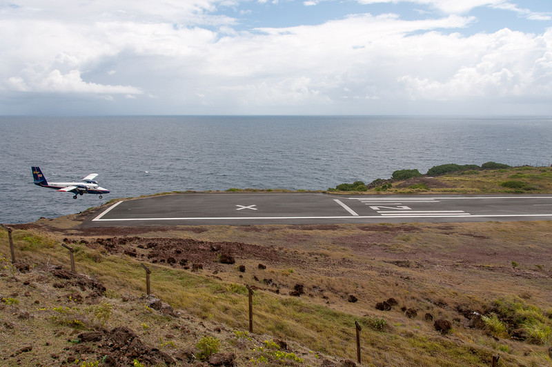 Plane landing on runway on the island of Saba