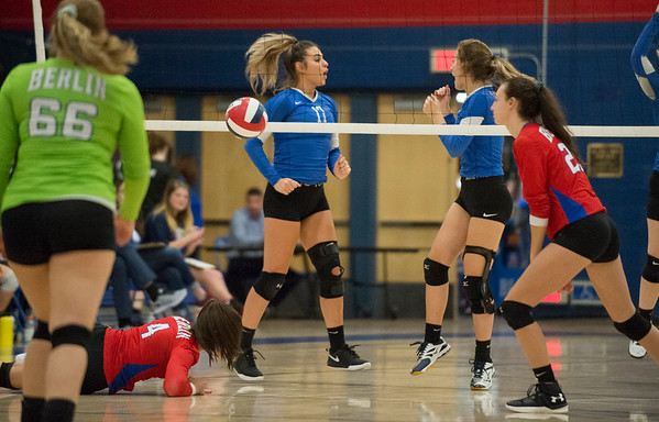10/21/19 Wesley Bunnell | StaffrrPlainville High School girls volleyball vs visiting Berlin High on Monday night. Plainville's Katherine Tanguay (17) and Wiktoria Galazyn (5) celebrate after a block.