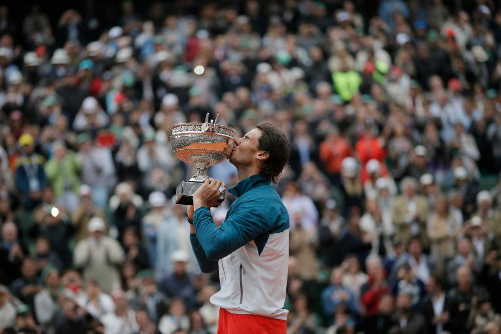. Spain\'s Rafael Nadal kisses the trophy after winning against compatriot David Ferrer in three sets 6-3, 6-2, 6-3, in the final of the French Open tennis tournament, at Roland Garros stadium in Paris, Sunday June 9, 2013. (AP Photo/Petr David Josek)
