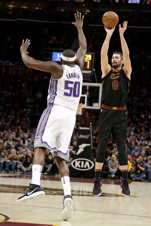 . Cleveland Cavaliers\' Kevin Love (0) shoots over Sacramento Kings\' Zach Randolph (50) in the first half of an NBA basketball game, Wednesday, Dec. 6, 2017, in Cleveland. (AP Photo/Tony Dejak)