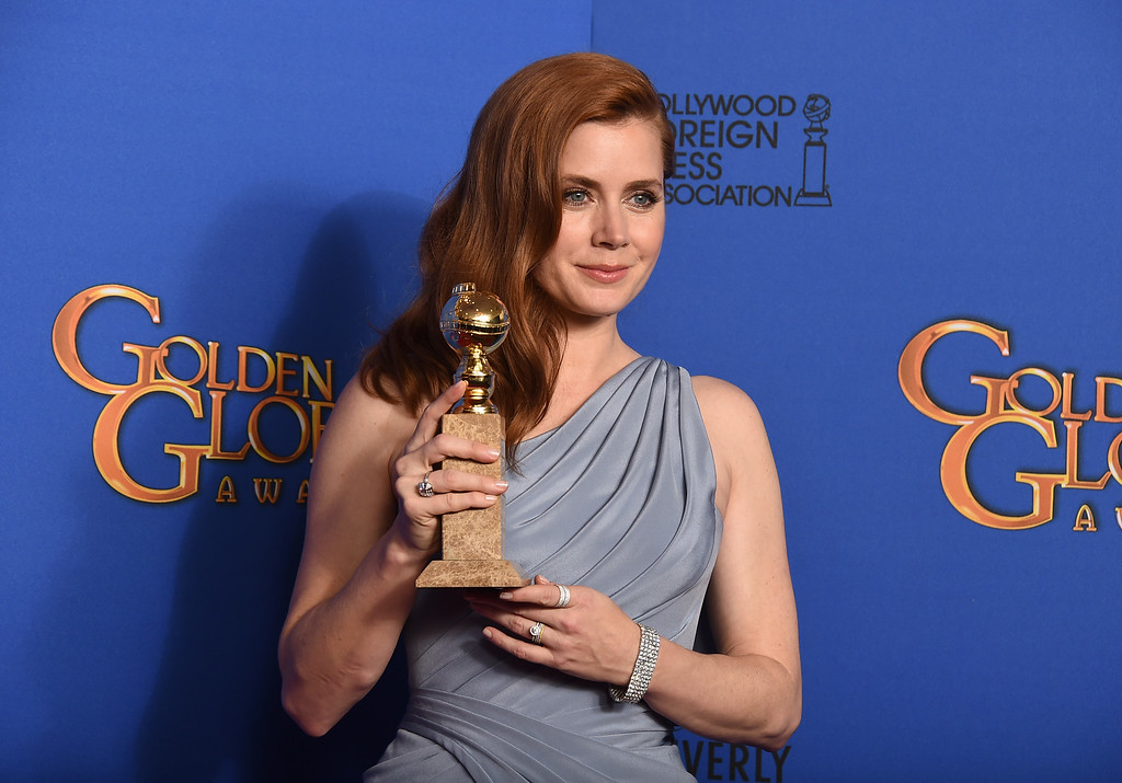 . Amy Adams poses in the press room with the award for best actress in a motion picture - musical or comedy for ìBig Eyesî at the 72nd annual Golden Globe Awards at the Beverly Hilton Hotel on Sunday, Jan. 11, 2015, in Beverly Hills, Calif. (Photo by Jordan Strauss/Invision/AP)