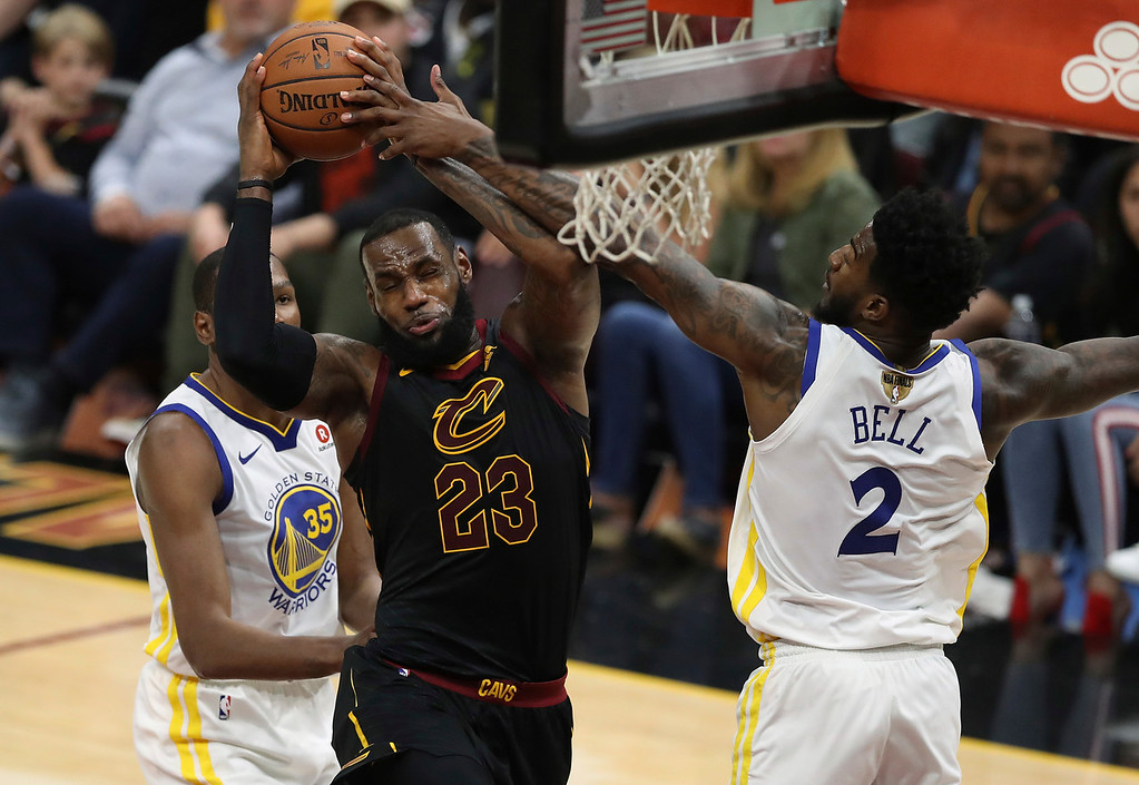 . Cleveland Cavaliers\' LeBron James is fouled by Golden State Warriors\' Jordan Bell during the first half of Game 3 of basketball\'s NBA Finals, Wednesday, June 6, 2018, in Cleveland. (AP Photo/Carlos Osorio)