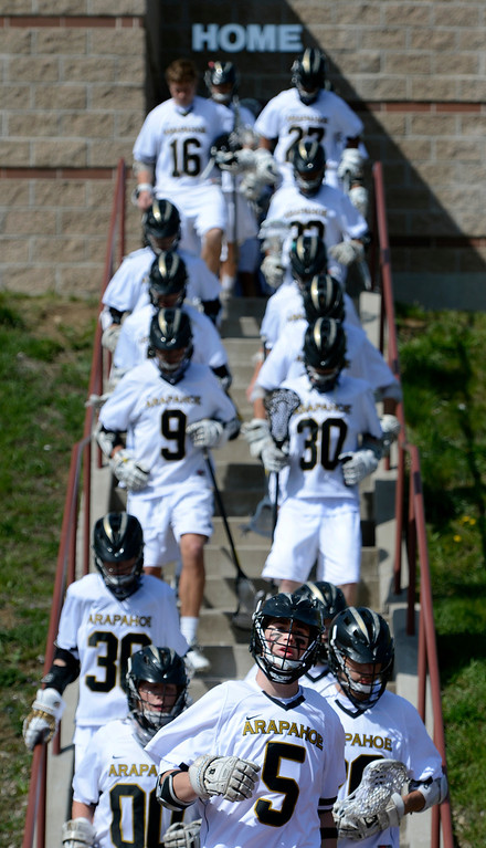 . LITTLETON, CO. - MAY 04:  Arapahoe\'s Blake Knobloch leads his team to the field for the varsity high school lacrosse game between the Arapahoe Warriors and the Regis Jesuit Raiders in Littleton, CO May 04, 2013. The Raiders won the game 9-6.  (Photo By Craig F. Walker/The Denver Post)