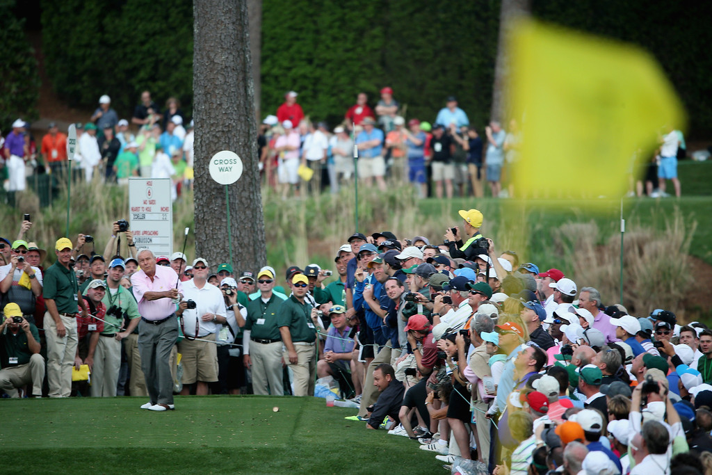 . Arnold Palmer hits his tee shot on the sixth hole during the 2014 Par 3 Contest prior to the start of the 2014 Masters Tournament at Augusta National Golf Club on April 9, 2014 in Augusta, Georgia.  (Photo by Andrew Redington/Getty Images)