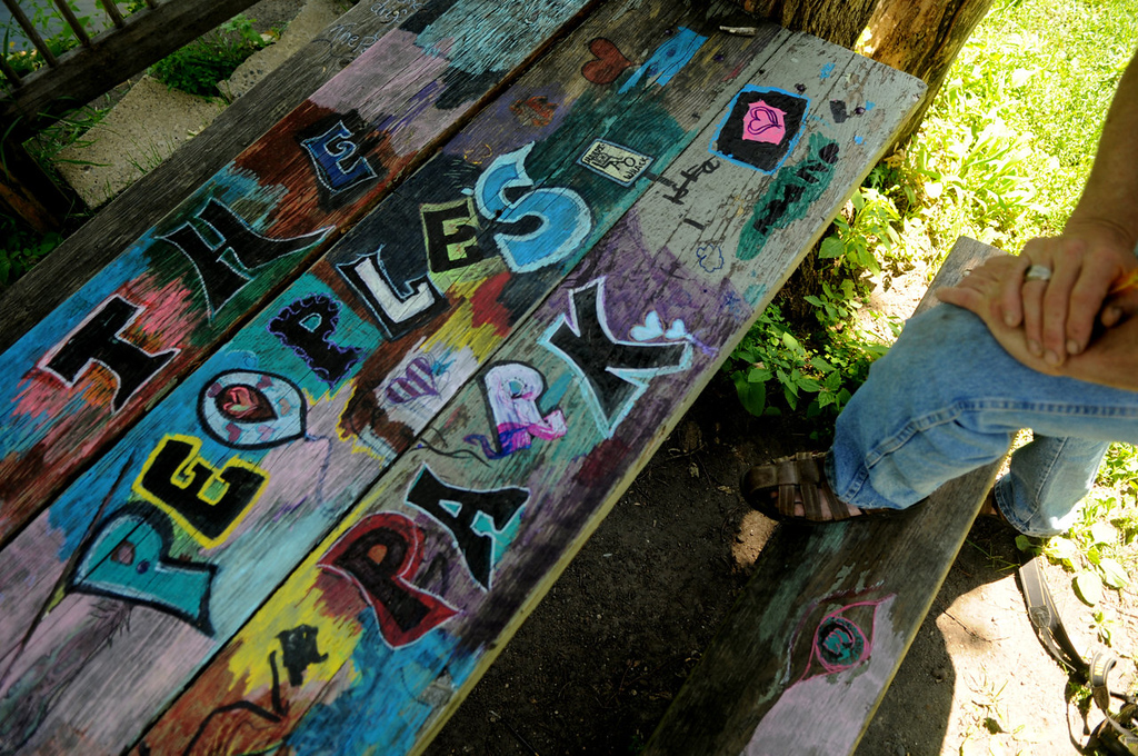""". Arjo Adams looks at the picnic table that someone painted in the \""""People\'s Park.\"""" \""""It\'s good,\"""" he said. \""""If you provide art tools people will do almost anything,\"""" he said. \""""This just happened.\"""""""
