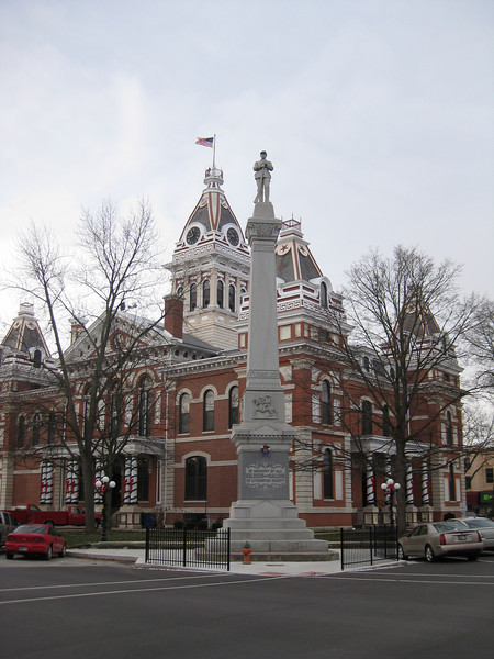 """""""Livingston County Courthouse, Pontiac, Illinois"""" - Daily Photo - 01/02/13  One of my favorite buildings in Illinois all decked out for the holidays.  President Theodore Roosevelt unveiled the Soldier's Monument (pictured) on June 3, 1903.    Pontiac is the county seat for Livingston.  Founded in the 1830's, the city grew with access to the railroad, remaining a stop for Amtrak to this day, and road infrastructure including Route 66 and now Interstate 55.  While distribution centers and other examples of economic diversification have been developed, since the late 1800's the city has been dependent on the Pontiac Correctional Center through local employment and associated spill-over benefits.    Then Governor Rod Blagojevich (we elected him twice remember) had proposed to close the Pontiac Correctional Center and President Barack Obama's administration was seeking to transfer Gitmo terrorists to a facility in Illinois with the current governor supporting the president.  This led to a failed """"Save Pontiac Prison"""" campaign and the closure process was initiated.  However, state Senator Dan Rutherford paid a visit to the US Attorney's office and began publicly urging connected individuals in corrections and staff of the former governor to come forward with information about the decision to close the center at Pontiac.  Well, the corrections center is now open, Blago received 14 years and the rest of the sordid story represents what we have come to expect from our politicians from Illinois."""