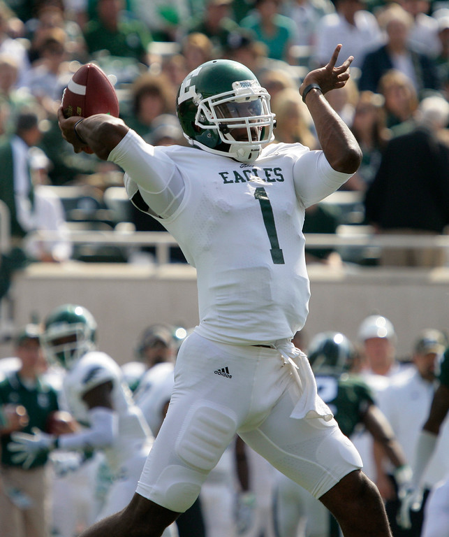 . Eastern Michigan quarterback Rob Bolden throws a pass against Michigan State during the first quarter of an NCAA college football game, Saturday, Sept. 20, 2014, in East Lansing, Mich. (AP Photo/Al Goldis)