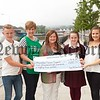 Anne Fallon presents a cheque for £2885 to Karen Murdock from Macmillan Cancer Support money raised from an Afternoon Tea held on the 8th May in Memory of her late husband Francie. Also pictured is Ann's children Eimear, Sean and Niamh. R1624002