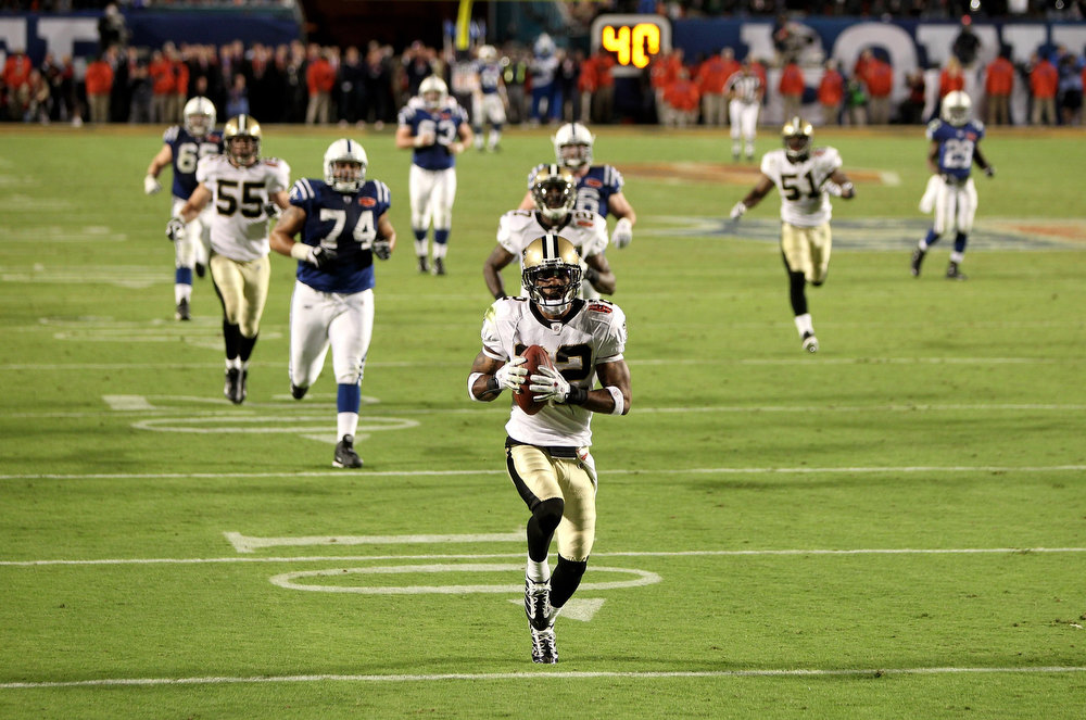 Description of . Tracy Porter #22 of the New Orleans Saints returns a interception for touchdown against of the Indianapolis Colts during Super Bowl XLIV on February 7, 2010 at Sun Life Stadium in Miami Gardens, Florida.  (Photo by Ezra Shaw/Getty Images)
