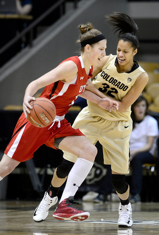 . Colorado\'s Arielle Roberson (right) guards Michelle Plouffe (left) Utah\'s during their basketball game at the University of Colorado in Boulder , Colorado January 8, 2013. BOULDER DAILY CAMERA/ Mark Leffingwell
