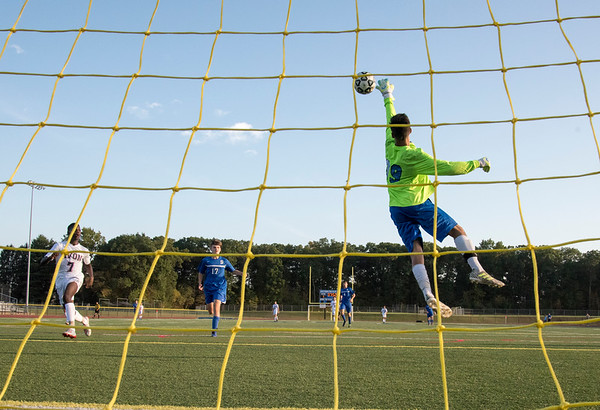 10/01/19 Wesley Bunnell | StaffrrSouthington boys soccer was defeated by Avon 3-2 on Tuesday afternoon at Southington High School. Goal keeper Ryan Lunn (99) jumps to stop a shot on goal.