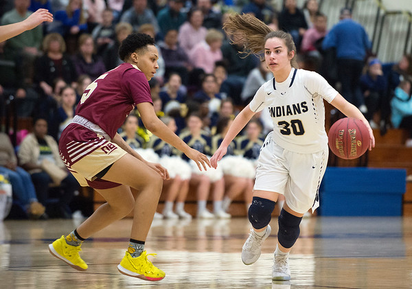 02/13/20 Wesley Bunnell | StaffrrNewington girls basketball defeated New Britain at home Thursday evening. Newington's Marliese Zocco (30) brings the ball downcourt while guarded by Raven-Symone Jarett (5).