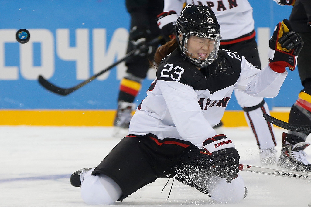 . Ami Nakamura of Japan lands on her knees as the puck get away from her during the game against Germany at the 2014 Winter Olympics women\'s ice hockey tournament at Shayba Arena, Thursday, Feb. 13, 2014, in Sochi, Russia. (AP Photo/Petr David Josek)