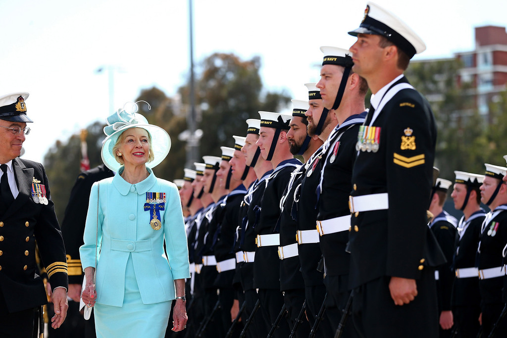 . Australia\'s Governor-General Quentin Bryce (2nd-L) is greeted by the Royal Australian Navy as she arrives at Garden Island in Sydney to attend the 2013 International Fleet Review on October 5, 2013. The International Fleet Review commemorates the 100 year anniversary of the Royal Australian Navy\'s fleet arriving into Sydney. Britain\'s Prince Harry is an official guest of the Australian Government and will take part in the fleet review during his two-day visit to Australia.  RYAN PIERSE/AFP/Getty Images
