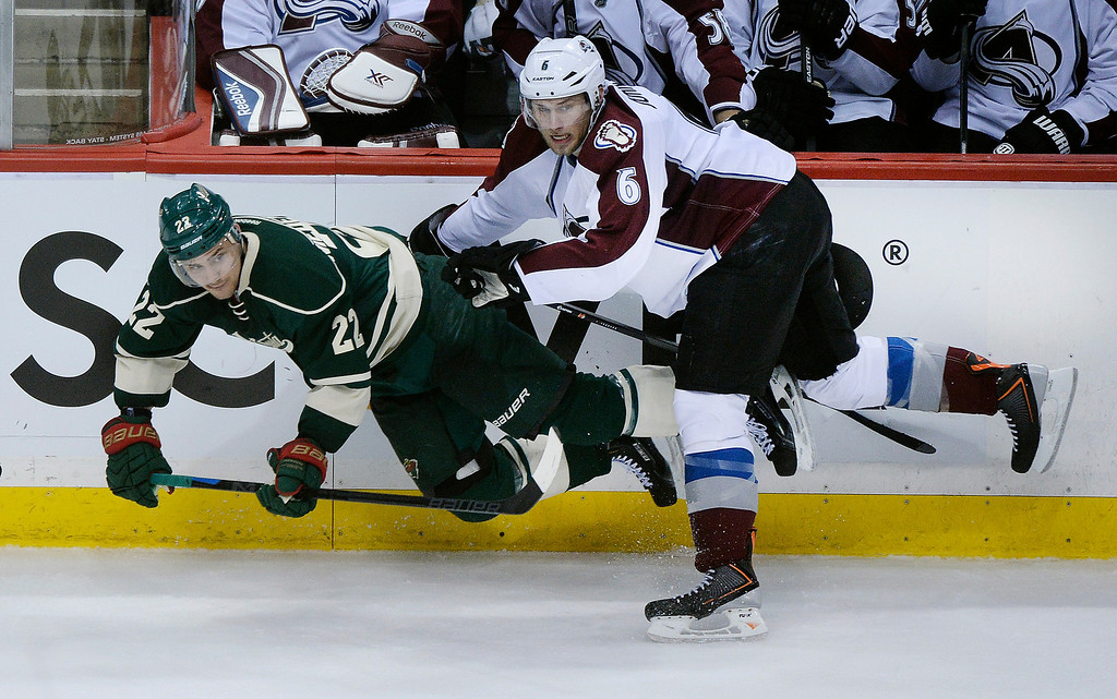 . Colorado defenseman Erik Johnson (6) shoved Minnesota wing Nino Niederreiter (22) into the boards in the second period.   (Photo by Karl Gehring/The Denver Post)