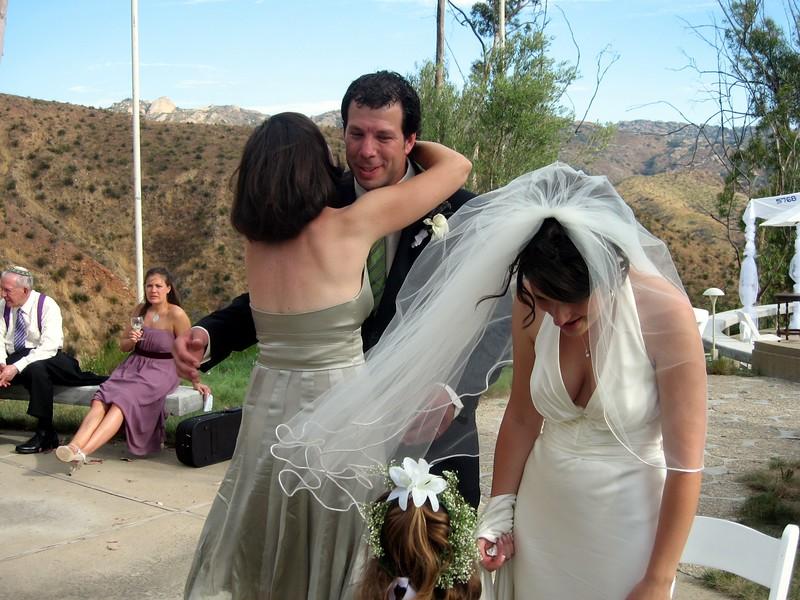 Rachel (sister of the groom) congratulates Avram