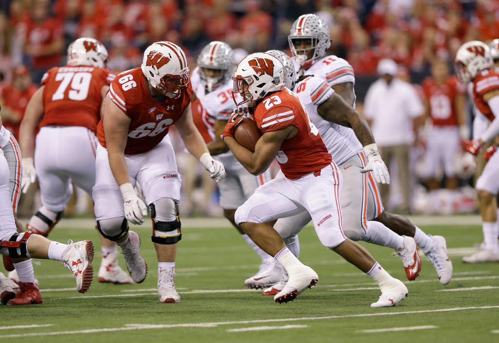 . Wisconsin running back Jonathan Taylor runs with the ball during the second half of the Big Ten championship NCAA college football game against Ohio State, Saturday, Dec. 2, 2017, in Indianapolis. (AP Photo/Michael Conroy)
