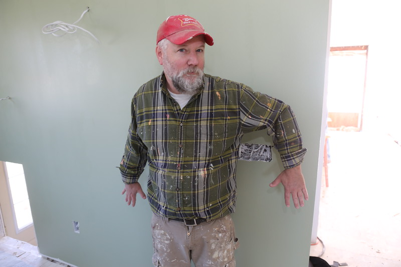 Dave's shirt  color-coordinates with the new kitchen wall
