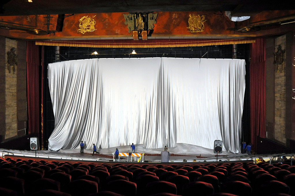 . Workers install a 94\'X46\' IMAX screen inside the TCL Chinese Theatre in Hollywood, CA August 23, 2013.  After a summer hiatus, the TCL Chinese Theatre is reopening as the world�s biggest IMAX Theatre with a showing of the Wizard of Oz on September 20th.(Andy Holzman/Los Angeles Daily News)