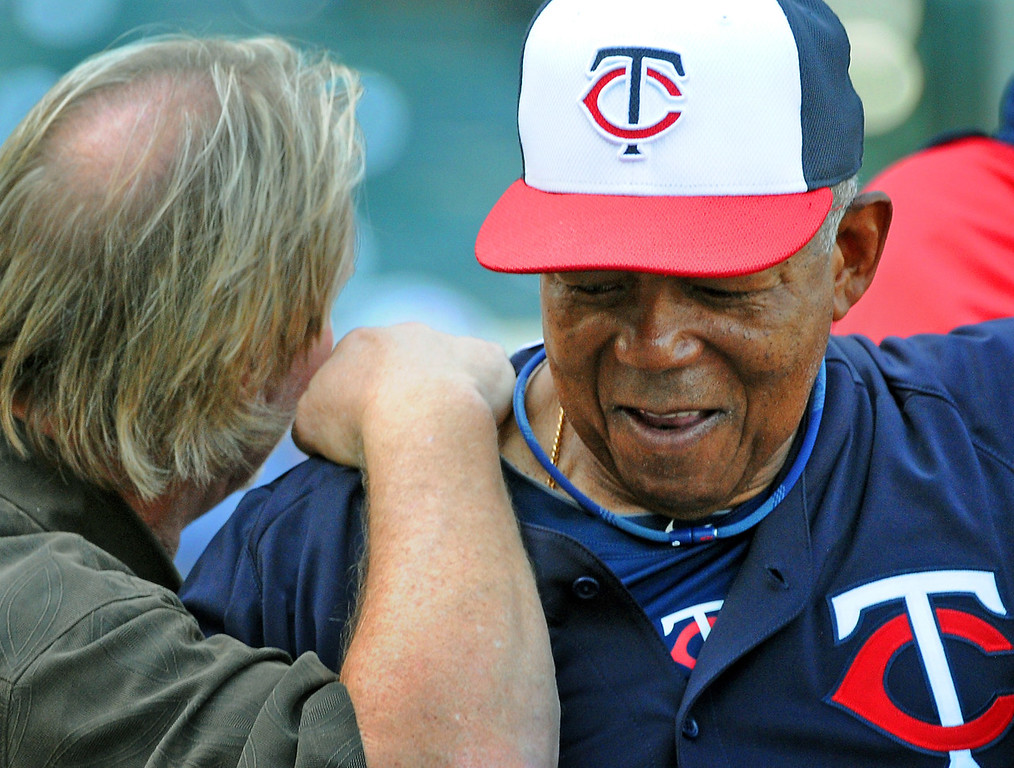 . #2 -- Twins coach and baseball Hall of Famer Tony Oliva (talking with former Twin Dan Gladden, left)  had his best season in 1973, the  inaugural season for the designated hitter, when he had 16 home runs, 92 RBIs and a .291 batting average.  (Pioneer Press: John Autey)