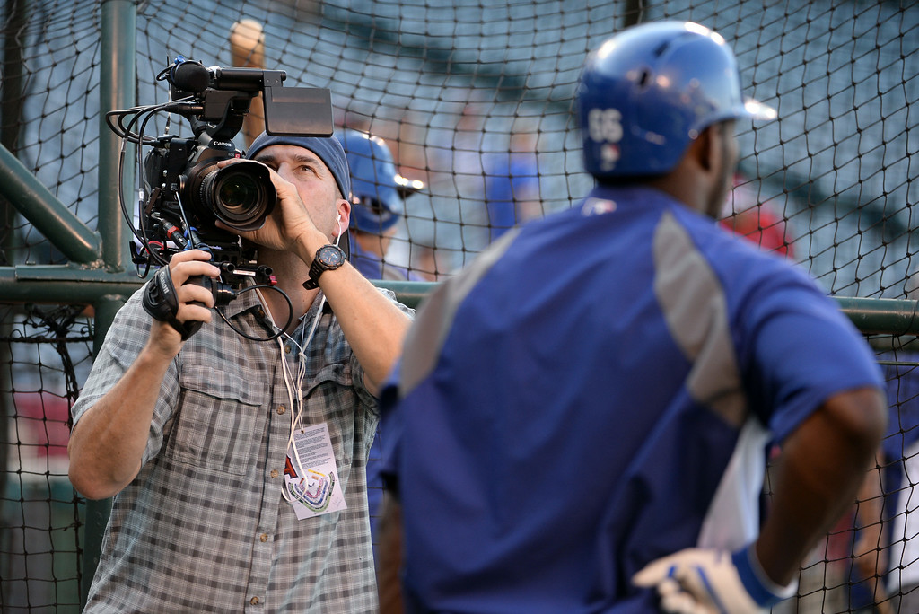 . Los Angeles Dodgers\' Yasiel Puig is filmed prior to a baseball game against the Los Angeles Angels at Anaheim Stadium in Anaheim, Calif., on Thursday, Aug. 7, 2014.  (Photo by Keith Birmingham/ Pasadena Star-News)