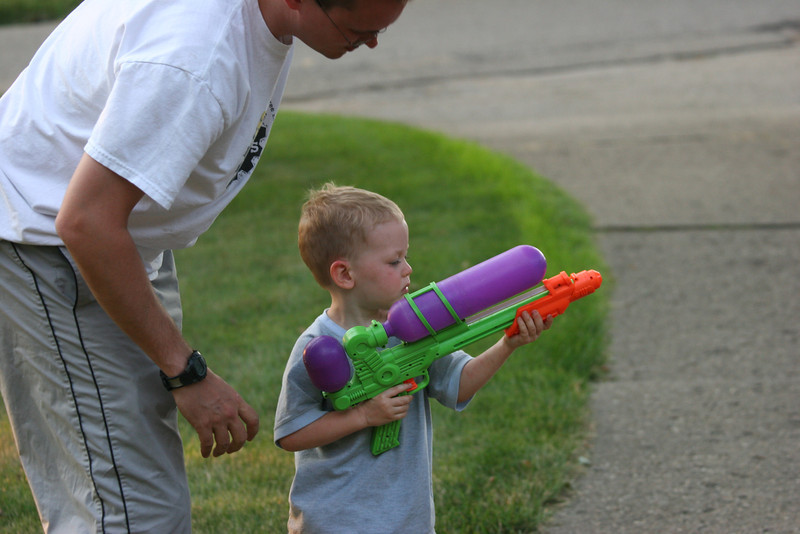 Aaron gets some shooting instruction from Daddy
