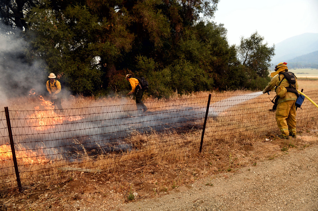 . Firefighters battle the Springs Fire near homes along Hidden Valley Rd in Thousand Oaks Friday, May 3, 2013. (Hans Gutknecht/LA Daily News)