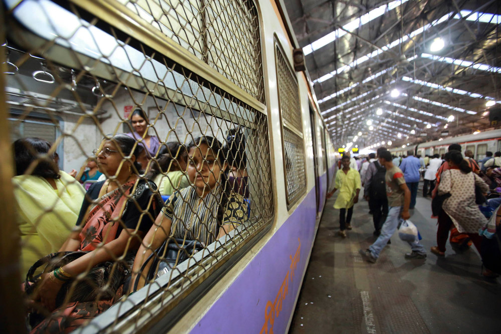 Description of . Women are pictured inside a carriage as they wait for the Ladies' Special train to move at Church Gate Railway Station in Mumbai December 6, 2012. In Mumbai there are two trains every day except Sunday reserved especially for women. In India some train compartments, or sometimes whole trains, are reserved specifically for female passengers in an effort to make their travel easier and more secure. The role and treatment of women in society has recently become a hot political issue in the country, since the Dec. 16 gang rape of a 23-year-old student in New Delhi, who later died of her injuries, and whose case has led to widespread protests in the region against violence against women. Picture taken December 6, 2012.          REUTERS/Navesh Chitrakar