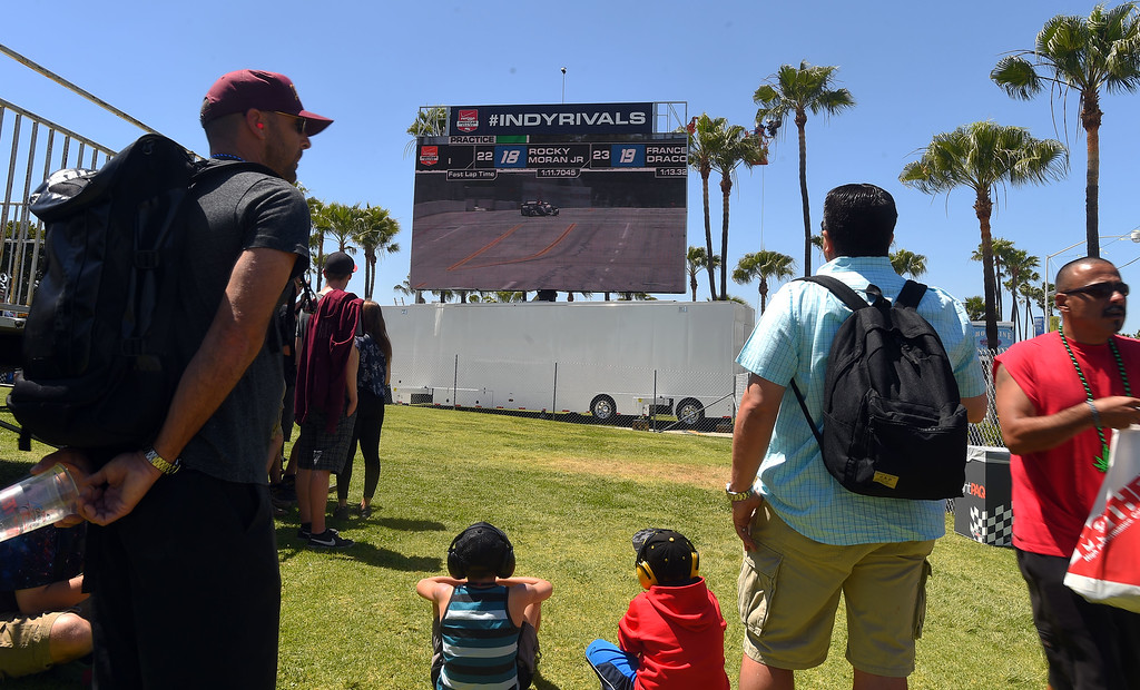 . Race fans watch the Indy cars practice on one of the large viewing monitors in Long Beach, CA on Friday, April 17, 2015. The 40th annual Toyota Grand Prix of Long Beach kicked off with practices for all of the racing divisions. (Photo by Scott Varley, Daily Breeze)