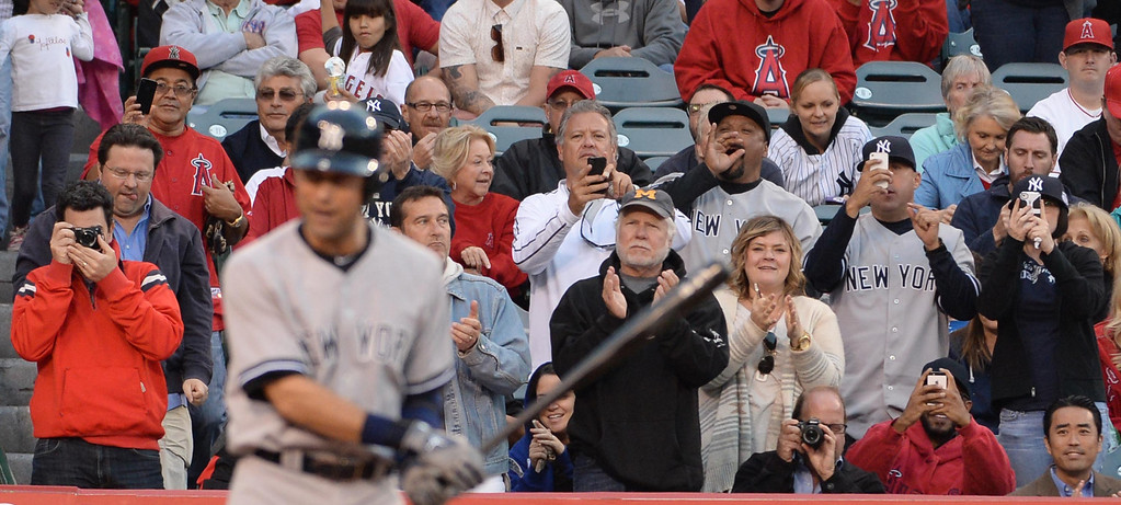 . Fans cheer as New York Yankees\' Derek Jeter is announced in the first inning of a baseball game against the Los Angeles Angels at Anaheim Stadium in Anaheim, Calif., on Tuesday, May 6, 2014.  (Keith Birmingham Pasadena Star-News)