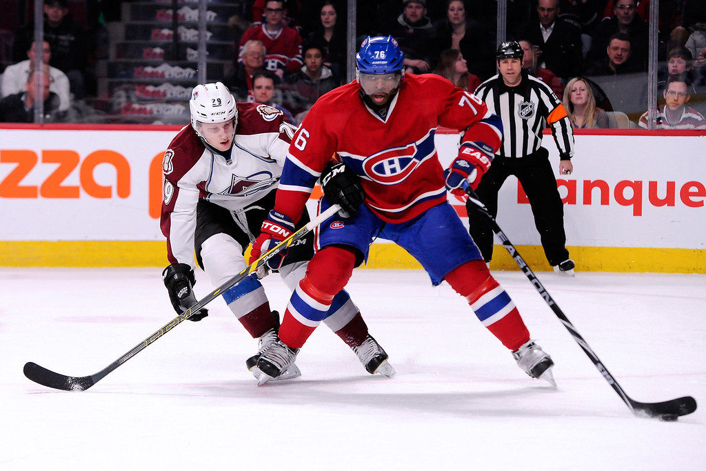 . MONTREAL, QC - MARCH 18:  P.K. Subban #76 of the Montreal Canadiens skates with the puck against Nathan MacKinnon #29 of the Colorado Avalanche away from it during the NHL game at the Bell Centre on March 18, 2014 in Montreal, Quebec, Canada.  (Photo by Richard Wolowicz/Getty Images)