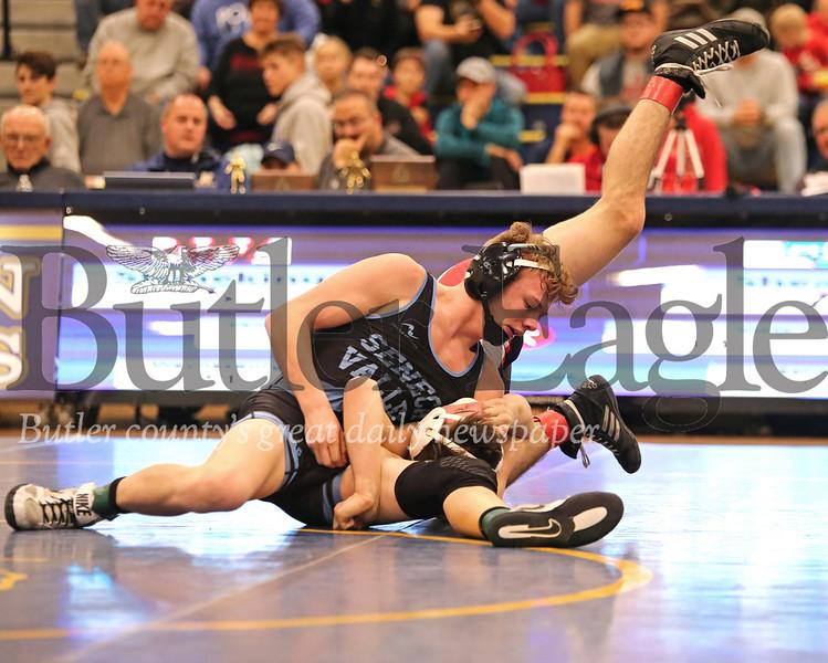 Seneca Valley's Chanz Shearer attempts a pin on Waynesburg's Colton Stoneking in Saturday's WPIAL championship at Norwin. Seb Foltz/Butler Eagle
