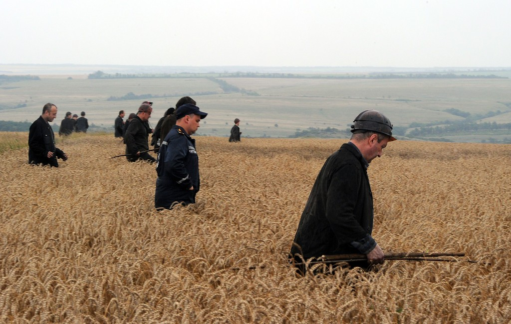 . A group of Ukrainian miners assist rescue workers in the search for bodies of victims in a wheat field at the site of the crash of a Malaysian airliner carrying 298 people from Amsterdam to Kuala Lumpur in Grabove, in rebel-held east Ukraine, on July 18, 2014. Pro-Russian separatists in the region and officials in Kiev blamed each other for the crash, after the plane was apparently hit by a surface-to-air missile. Members of the UN Security Council demanded a full, independent investigation into the apparent shooting down of a Malaysia Airlines jet over Ukraine.  AFP PHOTO / DOMINIQUE  FAGET/AFP/Getty Images