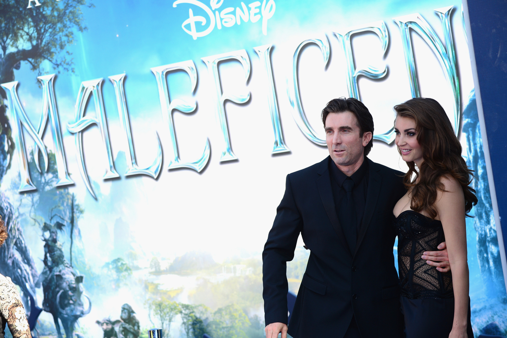 """. Actor Sharlto Copley and Tanit Phoenix  arrives at the World Premiere Of Disney\'s \""""Maleficent\"""" at the El Capitan Theatre on May 28, 2014 in Hollywood, California.  (Photo by Frazer Harrison/Getty Images)"""