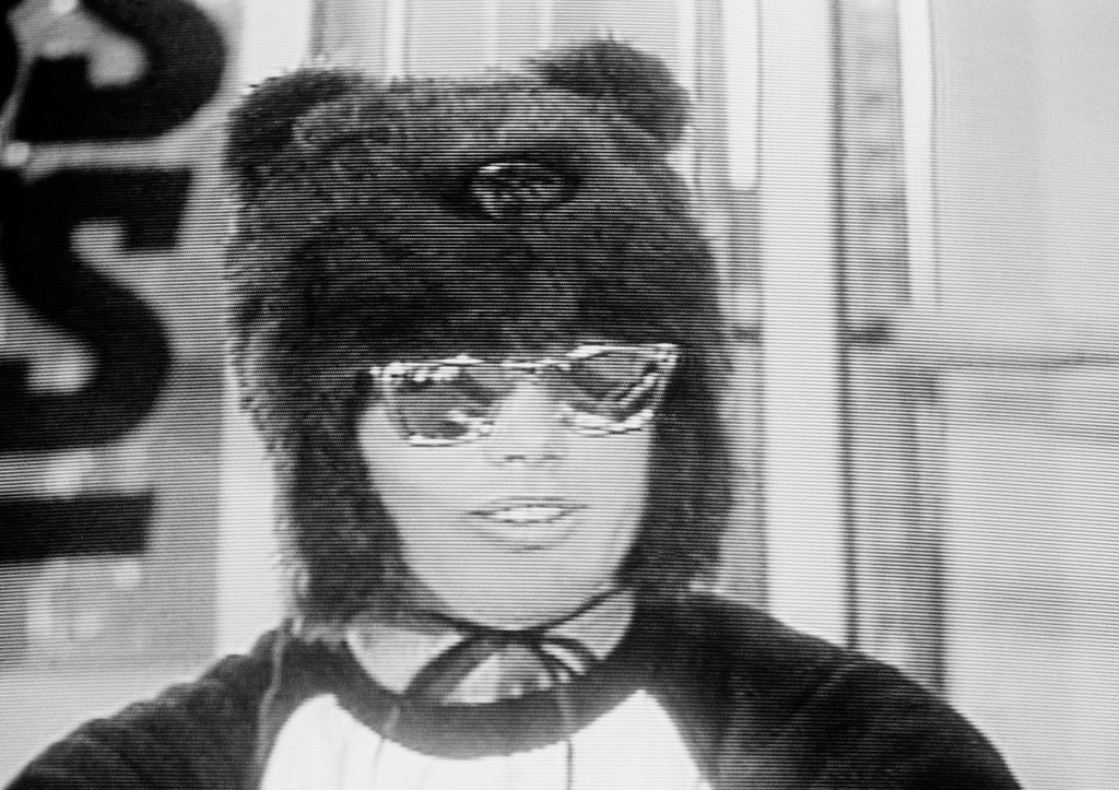. Chicago Bears Quarterback Jim McMahon displays his latest piece of headgear, a bear-head hat, photograph taken from a television monitor during a T.V. appearance at the Bears training camp, Sunday, Jan. 19, 1986, Lake Forest, Ill. McMahon was appearing with CBS-Sports commentator John Madden. (AP Photo)