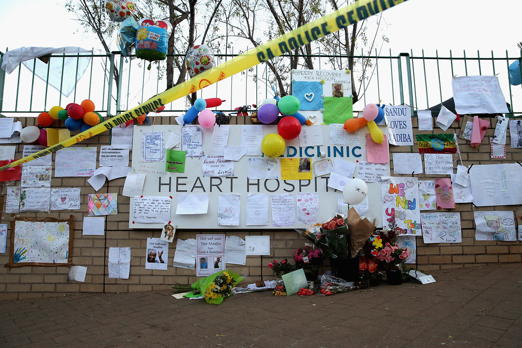 . PRETORIA, SOUTH AFRICA - JUNE 25:  Dozens of hand-made messages of support for former South African President Nelson Mandela are posted to the wall outside the Mediclinic Heart Hospital June 25, 2013 in Pretoria, South Africa. South African President Jacob Zuma confirmed Sunday that Mandela\'s condition has become critical since he was admitted to the hospital over two weeks ago for a recurring lung infection.  (Photo by Chip Somodevilla/Getty Images)