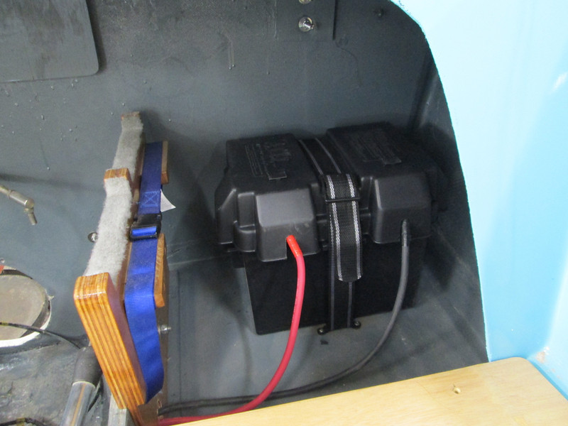 Another view of the battery box with battery and cables in place.