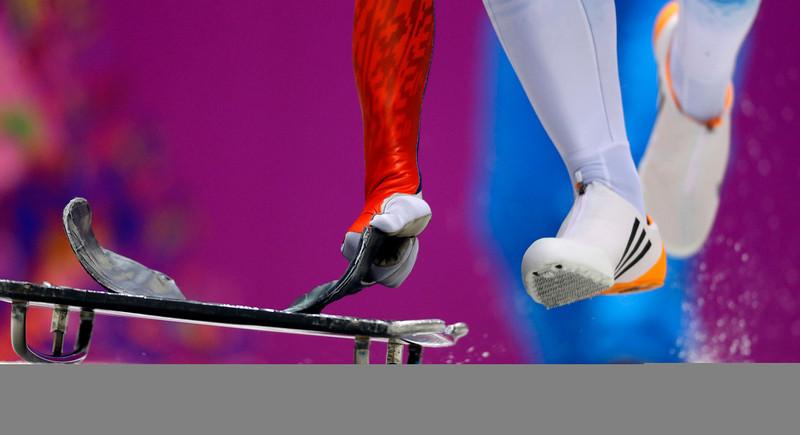 . Nikita Tregybov of Russia starts his second run during the men\'s skeleton competition at the 2014 Winter Olympics, Friday, Feb. 14, 2014, in Krasnaya Polyana, Russia. (AP Photo/Natacha Pisarenko)