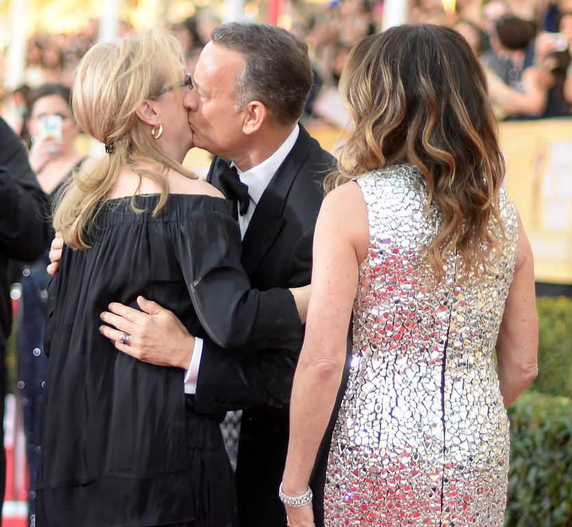 . Tom Hanks  gives Meryl Streepon a kiss on the red carpet at the 20th Annual Screen Actors Guild gives Awards  at the Shrine Auditorium in Los Angeles, California on Saturday January 18, 2014 (Photo by Hans Gutknecht / Los Angeles Daily News)