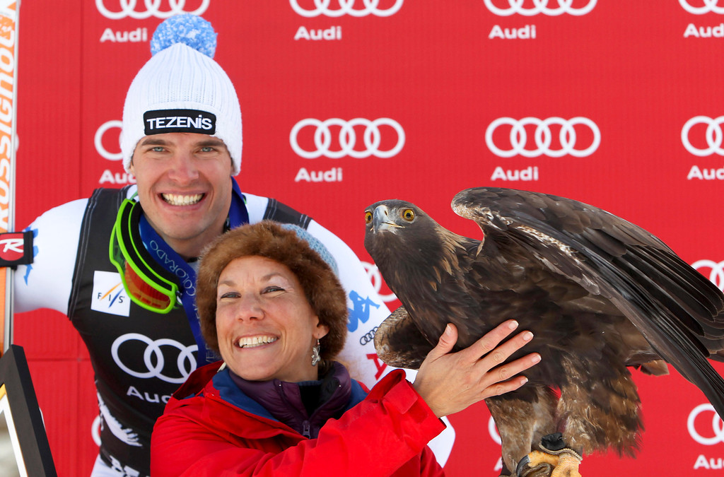 . Christof Innerhofer from Italy, stands at the podium with a golden eagle after winning at the men\'s World Cup downhill ski race in Beaver Creek, Colo., on Friday, Nov. 30, 2012. (AP Photo/Alessandro Trovati)