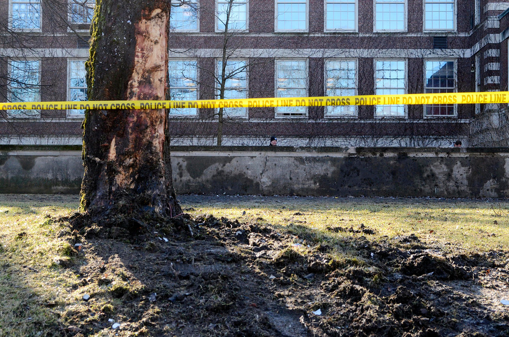 . Police investigate the scene of a fatal crash at Pittsfield High School on East Street the day after the accident in search of any debris related to the incident, Wednesday January 15, 2014. The victims were identified as Ernest Duck Jr., 37, of Pittsfield, who is believed to have been the driver of the 2013 Nissan Altima, and passenger Tariq Salley, 34, of Pittsfield.  (AP Photo Ben Garver, Berkshire Eagle Staff)