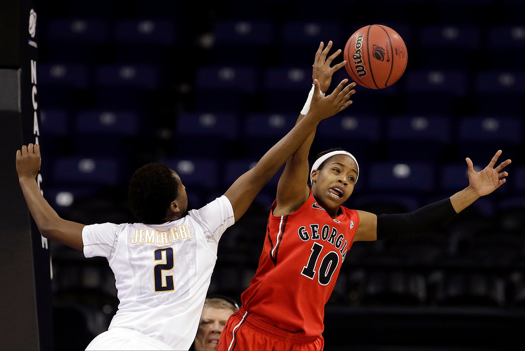 . Georgia\'s Jasmine James, right,  and California\'s Afure Jemerigbe, left,  reach for a loose ball during the first half in a regional final in the NCAA women\'s college basketball tournament, Monday, April 1, 2013, in Spokane, Wash. (AP Photo/Elaine Thompson)
