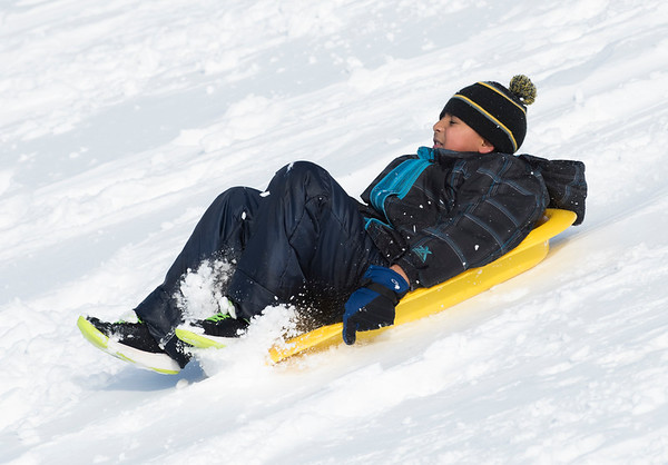 12/03/19 Wesley Bunnell | StaffrrA sledder at Smith Elementary School on Tuesday December 3, 2019.