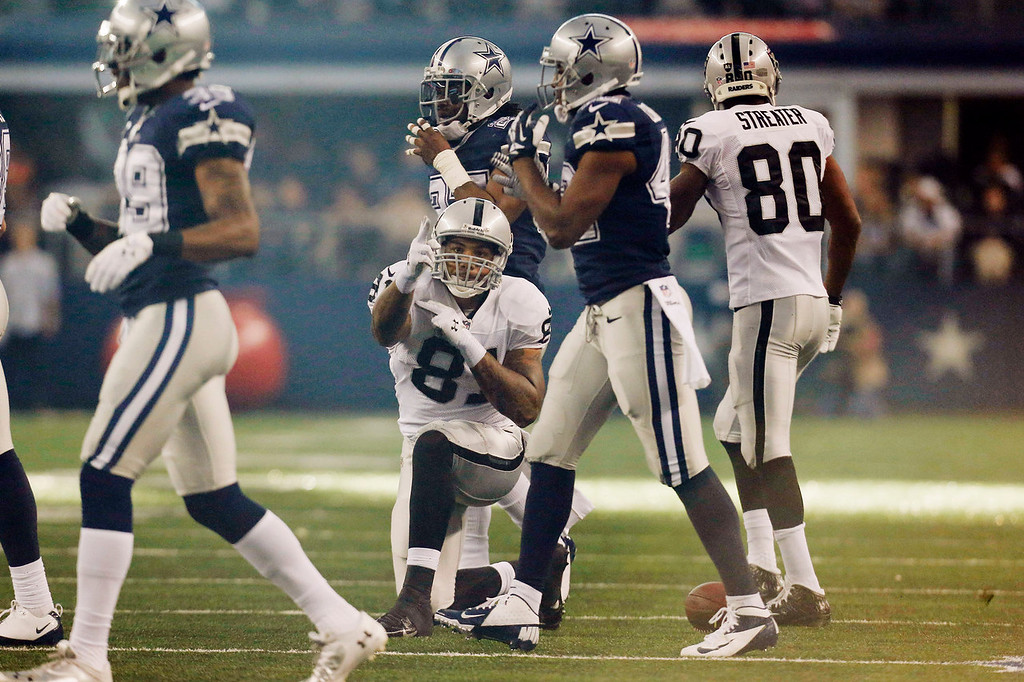 . Oakland Raiders tight end Mychal Rivera (81) celebrates after a run against the Dallas Cowboys during the first half of an NFL football game, Thursday, Nov. 28, 2013, in Arlington, Texas.  (AP Photo/Brandon Wade)