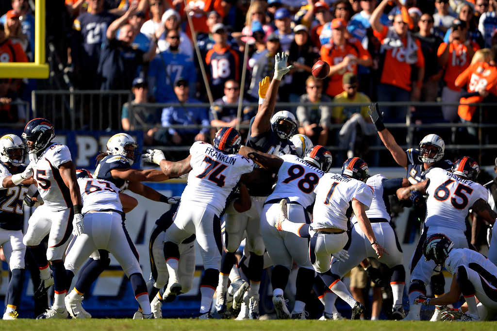 . SAN DIEGO, CA. December 14, - kicker Connor Barth #1 of the Denver Broncos makes the score 6-0  vs the San Diego Chargers at Qualcomm Stadium December 14, 2014 San Diego, CA (Photo By Joe Amon/The Denver Post)